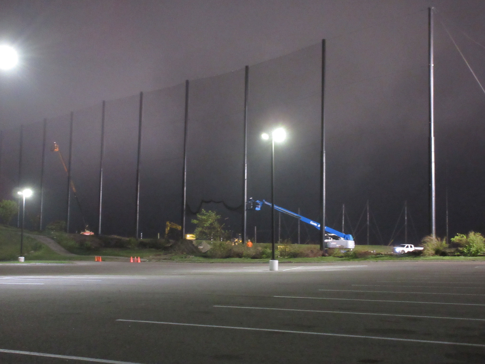 Fog rolled in at the end of the day installing golf netting panels